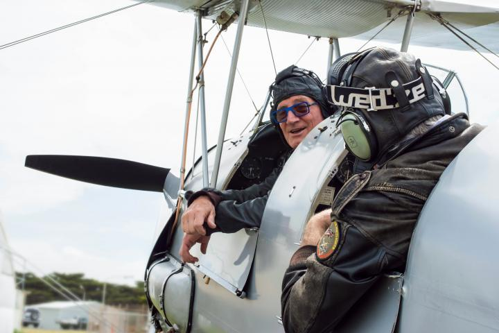 Two men in Toger Moth plane